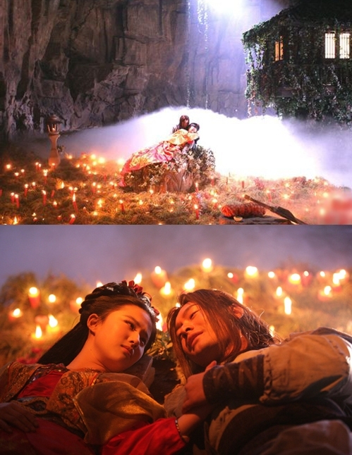 """<p class=""""Normal""""> Dương Quá (Huỳnh Hiểu Minh) và Tiểu Long Nữ (Lưu Diệc Phi) của <em>Thần điêu đại hiệp 2006</em> làm lễ thành thân trong ánh sáng ấm áp của hàng trăm ngọn nến.</p>"""