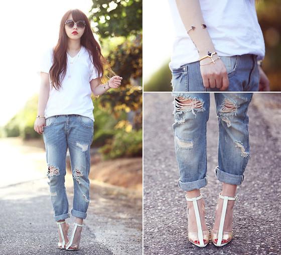 Quần jeans rách phủi bụi cho cô nàng cá tính