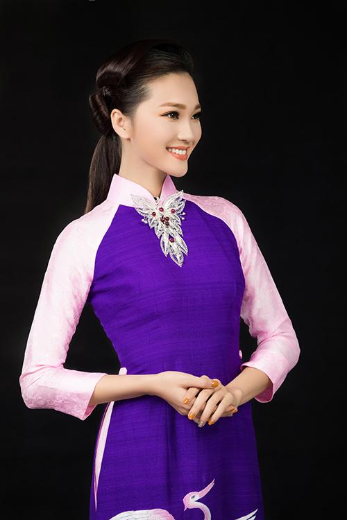 Cô gái có gương mặt đẹp nhất hoa hậu hoàn vũ nổi bật với tà áo dài đón xuân - 3