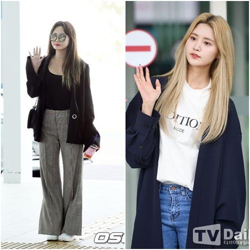 Cả LE và Jung Hwa đều mặc áo khoác mỏng khi ra sân bay vào sáng sớm.