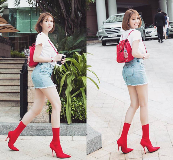 Chịu chi hàng chục triệu đồng để sắm đôi boots đỏ của Balenciaga nhưng Ngọc Trinh vẫn bị chê kém sang vì kết hợp với áo thun, váy jeans chưa thực sự phù hợp.