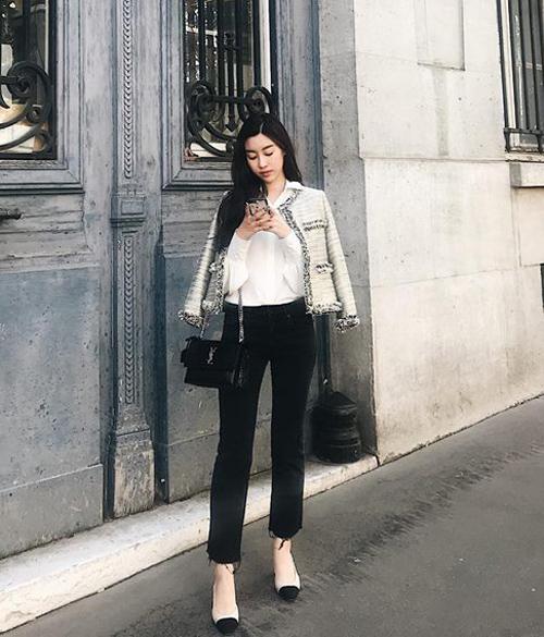 Túi YSL giá khoảng 43 triệu đồng được Mỹ Linh kết hợp với trang phục sang chảnh, giày cao gót Chanel trong một chuyến du lịch nước ngoài.