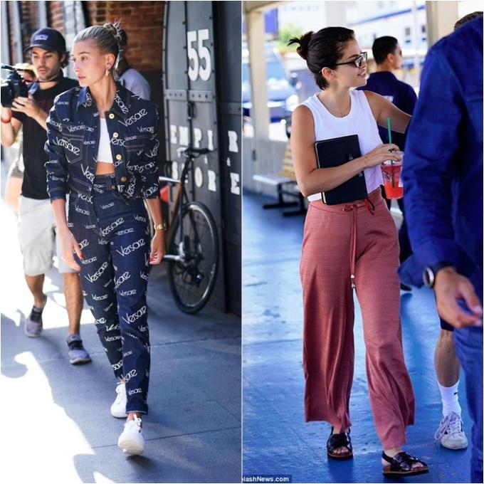 <p> Tiếp tục là một set đồ ấn tượng của Hailey: nguyên cây Versace chất lừ mix cùng giày thể thao trắng trendy. Đối với Selena, cô vẫn yêu thích phong cách thoải mái khi du lịch cùng bạn bè: croptop màu trắng mix quần ống rộng và sandals đen.</p>