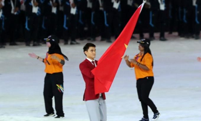 """<p> Đây không phải là lần đầu tiên """"Vua kiếm chém Đông Nam Á"""" Vũ Thành An có vinh dự cầm cờ cho đoàn Việt Nam. Trước đó, Thành An từng có vinh dự cầm cờ tại Olympic 2016 và SEA Games 2017.</p>"""
