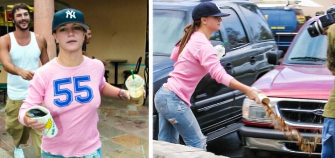 <p> Britney Spears gay gắt hất nước vào paparazzi.</p>