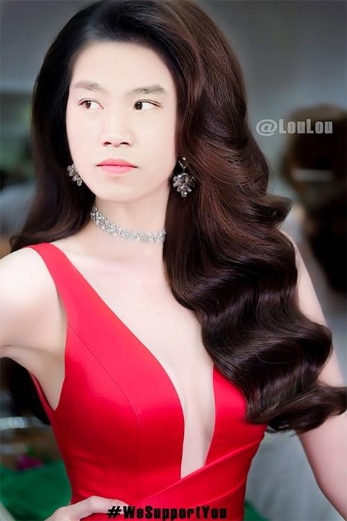 Văn Thanh đầy thần thái với váy xẻ ngực, tóc gợn sóng.