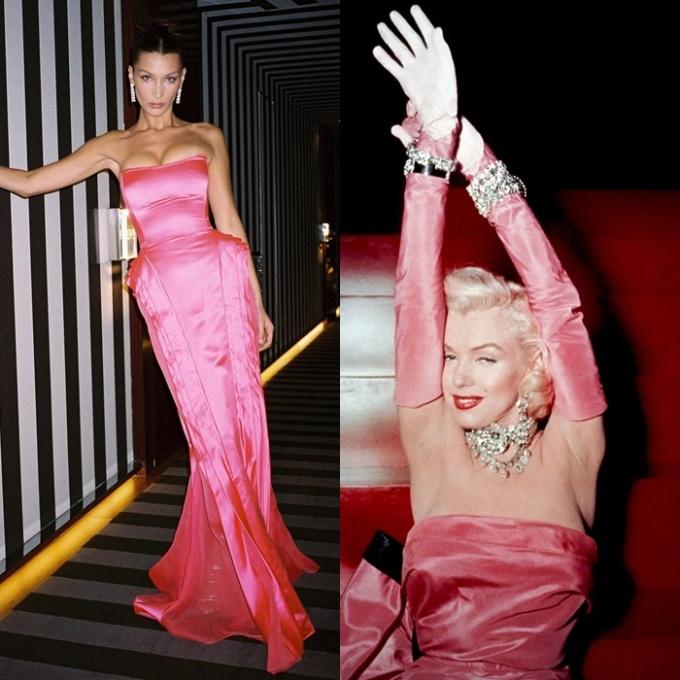 <p> Bella mặc bộ váy quây dài màu hồng rực rỡ bằng lụa satin của Jean Paul Gaultier (thuộc BST Mùa thu 2006). Thiết kế này gợi nhớ đến hình ảnh của minh tinh huyền thoại Marilyn Monroe trong bộ phim <em>Gentlemen Prefer Blondes</em> năm 1953.</p>