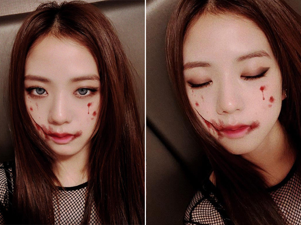 Cô nàng xinh đẹp Ji Soo cũng tự tạo cho mình hình tượng đúng chất lễ hội ma quỷ bằng cách make-up tông đỏ đày máu me. (samuel)