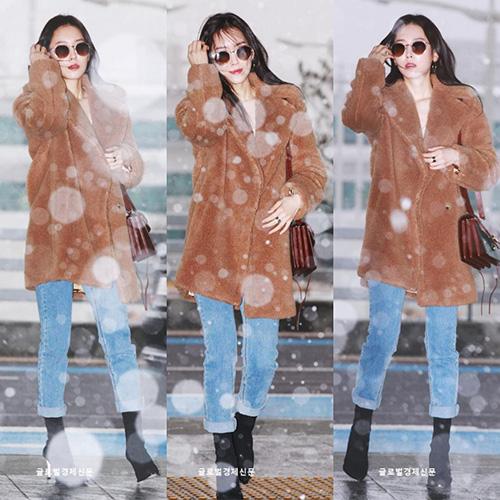 Nữ diễn viên Seo Hyun Jin là khách mời của MAMA. Ngôi sao ra sân bay khi tuyết rơi.
