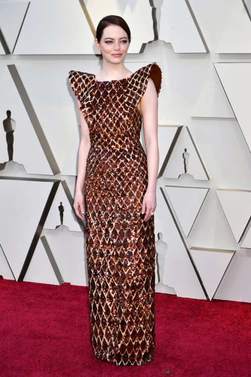 Emma Stone chưa bao giờ gây thất vọng về phong cách. Bộ đầm Louis Vuitton cô chọn mặc năm nay tiếp tục được đánh giá cao.