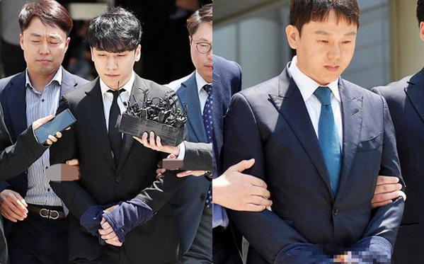 Seung Ri, Yoo In Suk bị còng tay áp giải nhưng sau đó được trả tự do.