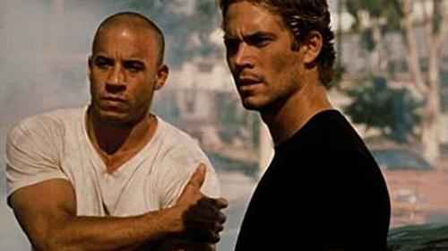 Dominic Toretto (trái) và Brian khi mới làm quen với nhau trong phần 1.