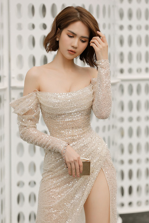 Tóc ngắn cũng không làm khó cô nàng khi diện váy dạ hội đi tiệc với cách tạo kiểu và trang điểmphù hợp gương mặt.