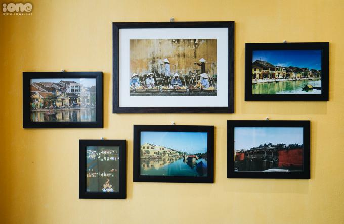 <p> Các không gian khác trong quán treo những bức ảnh về cuộc sống, con người ở Hội An.</p>