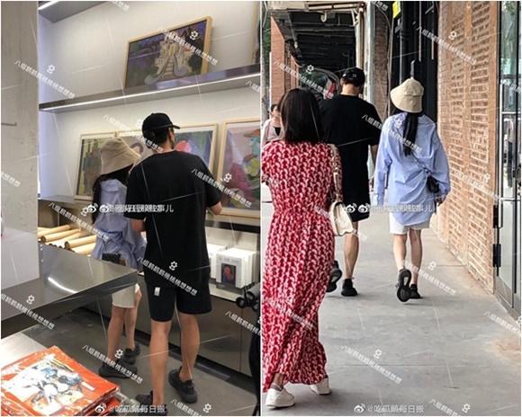 Ngụy Đại Huân đi dạo cùng một cô gái ở Bắc Kinh.