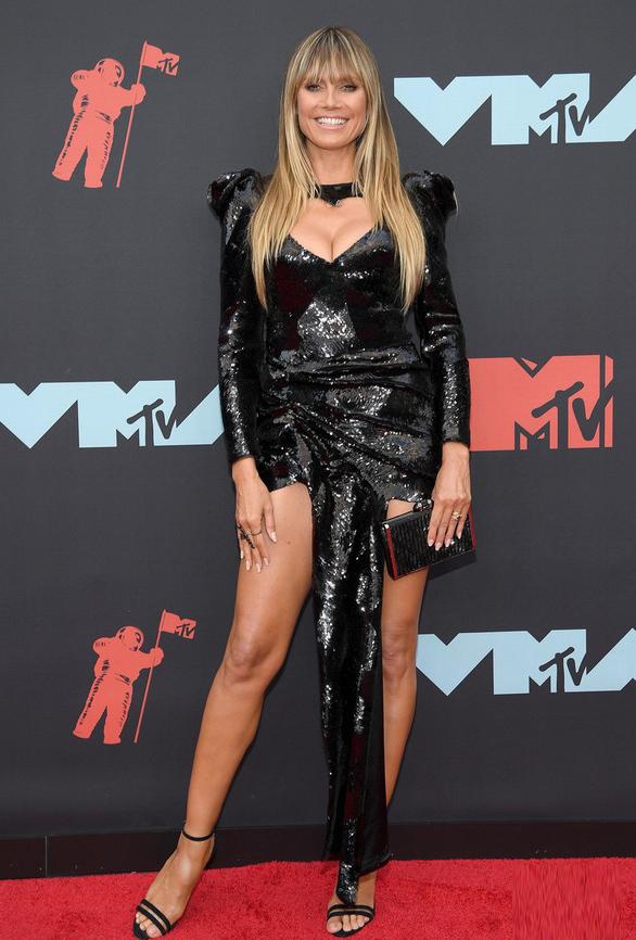 <p> Siêu mẫu Heidi Klum vẫn có vóc dáng quyến rũ ở tuổi 46.</p>