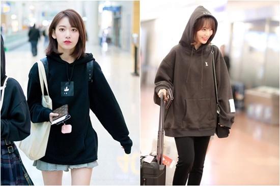 Áo hoodie rộng không còn là item khiến Sakura giấu mình khỏi ống kính. Bằng cách kết hợp cùng váy xếp ly, quần skinny, nữ idol có set đồ vừa năng động, vừa thời trang.