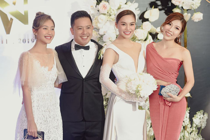 Trang Pháp mặc màu hồng lệch tông ở đám cưới Giang Hồng Ngọc.