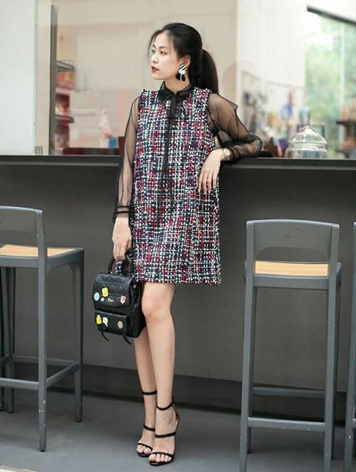 Hoàng Thùy Linh hóa cô tiểu thư với chiếc váy dáng xòe sử dụng chất liệu dành cho giới nhà giàu.