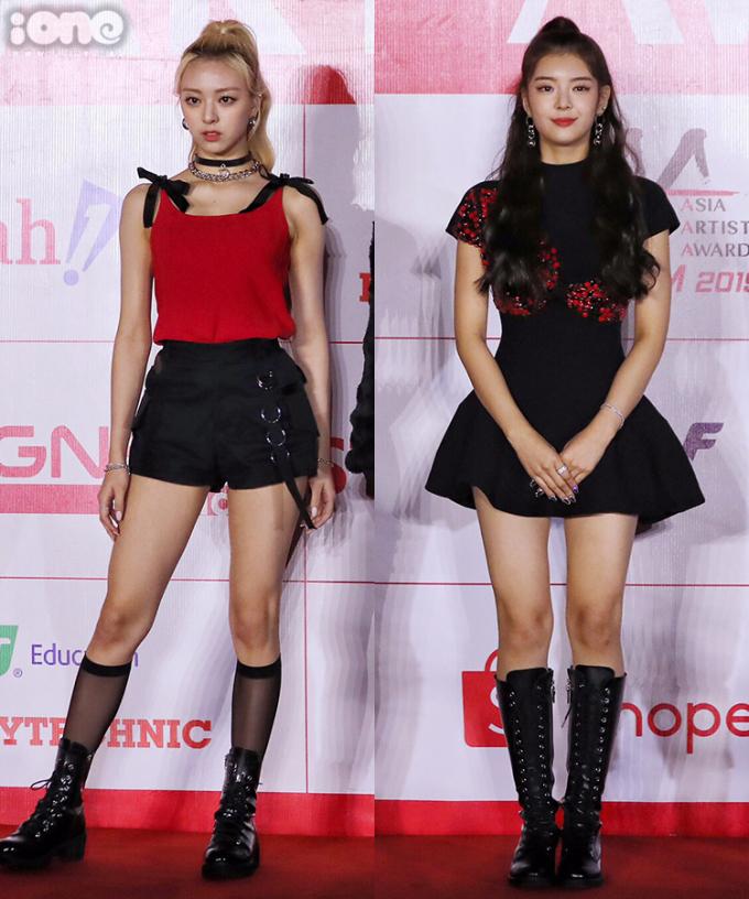 <p> Các thành viên ITZY chọn đồng phục màu đỏ - đen nổi bật, trong đó Yuna và Lia là nổi bật hơn cả. Cả hai nữ idol vốn được khen có thân hình cao ráo, khí chất high fashion nên mặc rất tôn đồ. Trong khi Yuna diện tanktop đỏ đính nơ kèm quần shorts cá tính, Lia lại sang chảnh hơn cùng váy xòe.</p>
