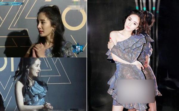 Mặc váy ngắn, Dương Mịch liên tục chà xát hai tay khi tạo dáng. Chụp ảnh xong, cô nàng nói nhỏ với MC: Thật sự lạnh quá đi mất!.