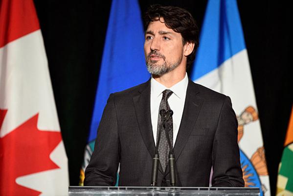 Thủ tướng Trudeau trong buổi tưởng niệm nạn nhân tại thành phố Edmonton hôm 12/1. Ảnh: Reuters.