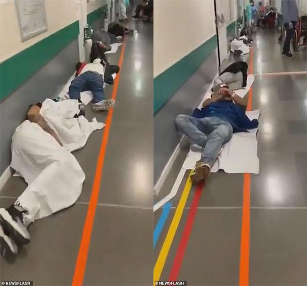 Bệnh nhân nằm dọc hành lang chờ được khám bệnh.