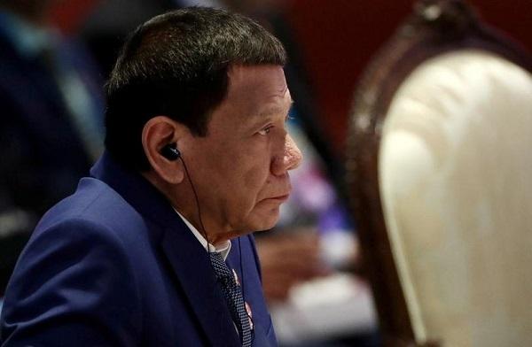 Philippine President Rodrigo Duterte attends a plenary session at a regional summit in Bangkok, Thailand November 2, 2019. REUTERS/Athit Perawongmetha